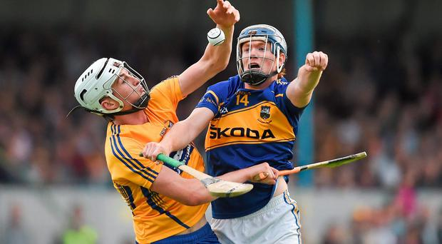 Clare's Conor Cleary is challenged for possession by Jason Forde of Tipperary during their Munster U-21 hurling semi-final at Cusack Park. Photo: Diarmuid Greene / SPORTSFILE