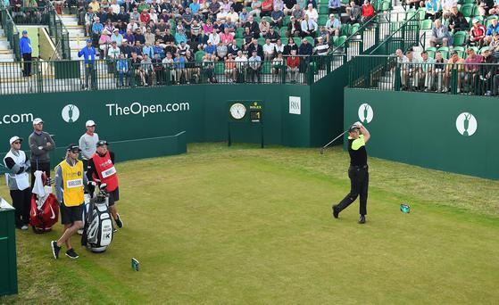David Howell of England hits the opening shot of the first round of The 143rd Open Championship at Royal Liverpool on July 17, 2014 in Hoylake, England.