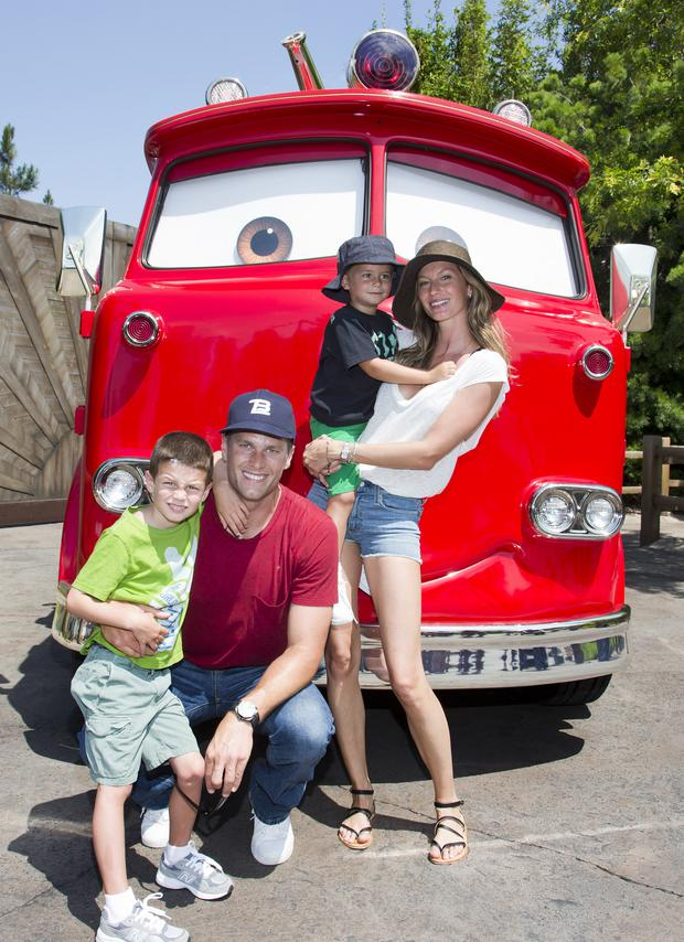 Tom Brady, his son Jack, 5, Gisele Bundchen, and their son Benjamin, 3, pose with Red the Fire Truck at Cars Land at Disney California Adventure park