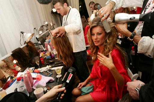 Model Gisele Bundchen is interviewed as she prepares backstage for The Victoria's Secret Fashion Show at the 69th Regiment Armory November 9, 2005