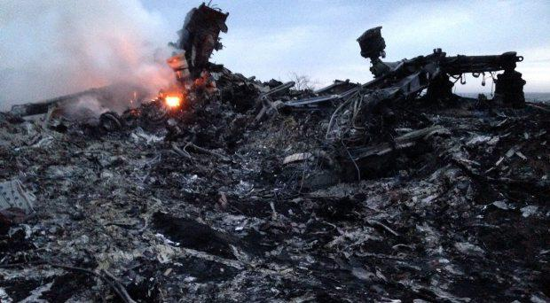 Smoke rises from the debris of Malaysia MH17 at the crash site in Ukraine