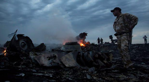 Fires burn as night falls on the crash site of Malaysia MH17 in Ukraine