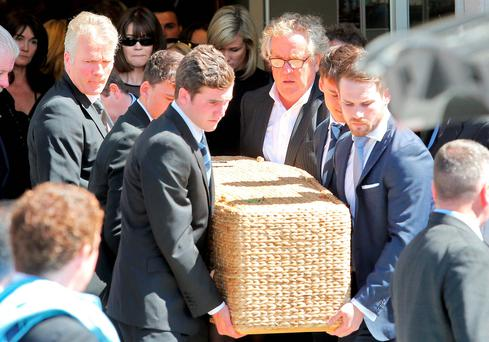 David Marshall (wearing glasses) helps carry the coffin of his son Daniel at his funeral yesterday. Photo: Collins