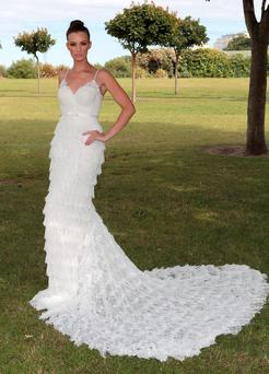 Model Karen Fitzpatrick showcases a designer wedding dress. Photo: Brian McEvoy