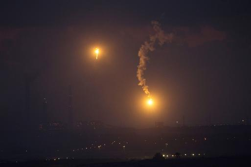 Flares fired by the Israeli military are seen above the northern Gaza Strip, after a five-hour humanitarian truce REUTERS/Ronen Zvulun