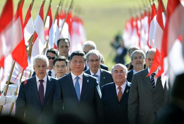 China's President Xi Jinping (front, centre) - in Brazil to attend the sixth summit of the BRICS - insists his country's financial reform process should not be subject to scrutiny by the rest of the world. Photo: EDILSON RODRIGUES/AFP/Getty Images