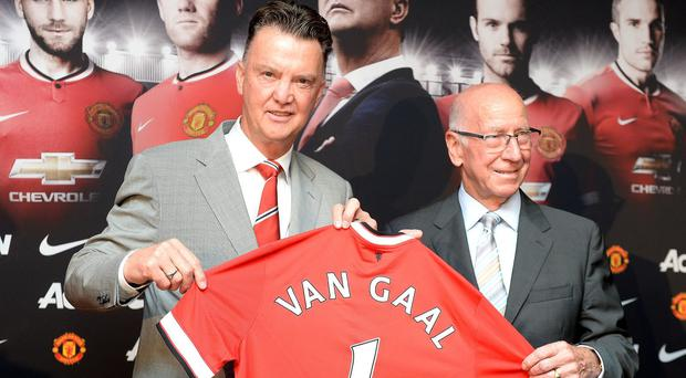 New Manchester United manager Louis van Gaal with Sir Bobby Charlton at Old Trafford, Manchester. Martin Rickett/PA Wire