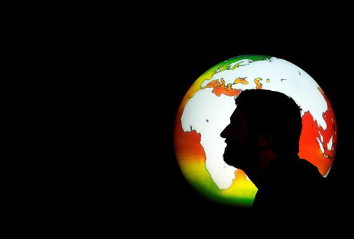 Zack DEnfeld from Phibsboro who is a co curator from coclimate takes a closer look at a 100 year climate model of the Earth at the Science Gallery in Trinity College Dublin. Photo: Steve Humphreys