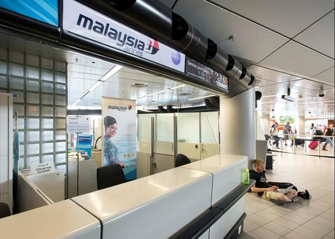 The desk of Malaysia Airways is seen at Schiphol Airport