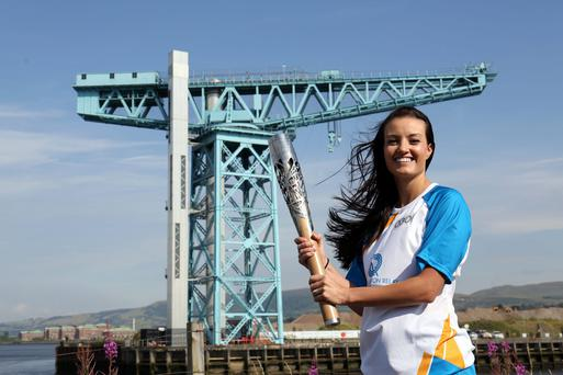 Handout photo from Glasgow 2014 Queen's Baton Relay of Batonbearer 030 Lynne Mitchell with the Glasgow 2014 Queen's Baton at the Titan crane in Clydebank in West Dunbartonshire
