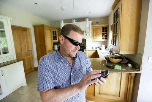 Paraic Barnes from Ennis Co. Clkare who is Visually impaired using his iPhone that helps him with his daily life Picture Credit Brian Gavin Press 22