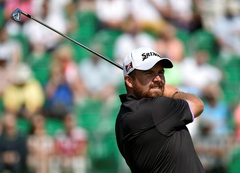 Shane Lowry of Ireland watches his tee shot on the fourth hole during the second round of the British Open Championship at the Royal Liverpool Golf Club in Hoylake
