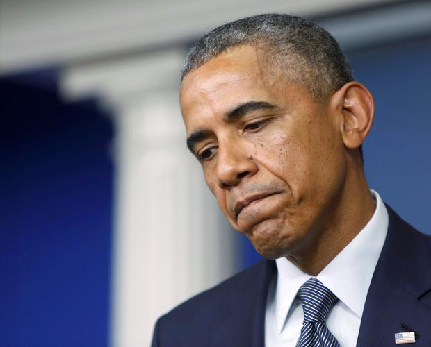 U.S. President Barack Obama pauses while speaking about the situation in Ukraine during a news conference at the White House in Washington DC