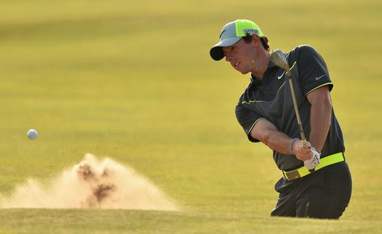 Rory McIlroy of Northern Ireland hits from a bunker on the 16th hole during the second round of The 143rd Open Championship at Royal Liverpool