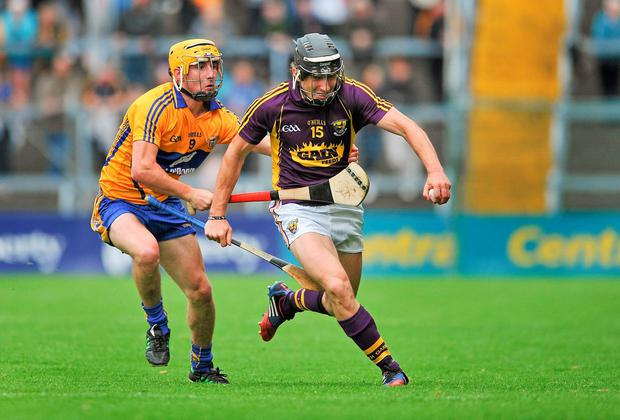 Wexford's Liam Óg McGovern gets away from Colm Galvin of Clare in their qualifier replay. Photo: Dáire Brennan / SPORTSFILE