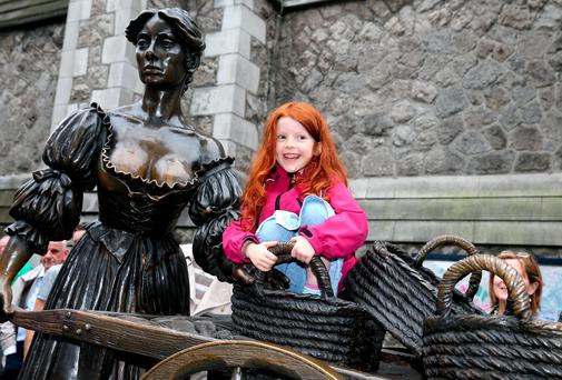5-year-old Maya O' Mahoney from Inchicore in Dublin at thr unveiling of the Molly Malone Statue at its new location in Suffolk Street in Dublin