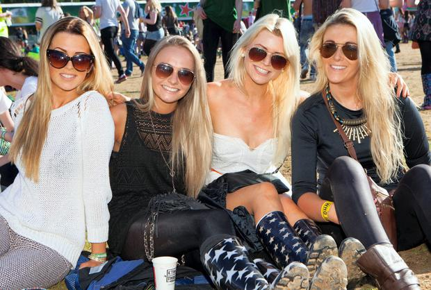 Leda Connaughton, Nicki Bailey, Bex Humphries and Johanna Ryan from Blackrock take in the evening sunshine on the first day of Longitude 2014 in Marley Park. Picture: Tony Kinlan