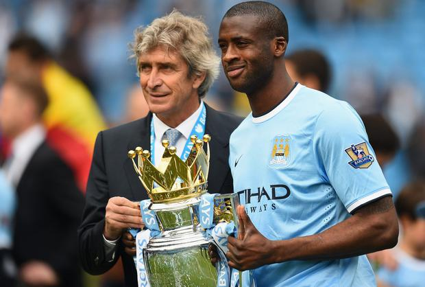 Manchester City manager Manuel Pellegrini looks set to hold on to his star midfielder Yaya Toure after the Ivory Coast international said he will honour his contract which runs until 2017. Photo: Shaun Botterill/Getty Images