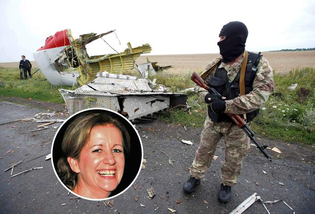 A pro-Russian separatist stands at the crash site of Malaysia Airlines flight MH17, near the settlement of Grabovo in the Donetsk region. Inset: Irish woman Edel Mahady, who died in the missile attack on MH17