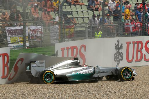 Lewis Hamilton of Great Britain and Mercedes GP crashes during qualifying ahead of the German Grand Prix at Hockenheimring in Hockenheim