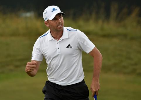 Sergio Garcia of Spain reacts after making his par putt on the 15th green during the third round of the British Open Championship at the Royal Liverpool Golf Club in Hoylake