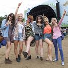 Revelers enjoy day 2 of Longitude 2014 in Marley Park. Pictured: Denise Duggan, Aoife Brosnan, Nicola Murphy, Katie Walsh, Grace O'Donoghue and Karen Moynihan from Killarney. Photo: Tony Kinlan