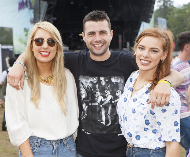 Revelers enjoy day 2 of Longitude 2014 in Marley Park. Pictured: Erin Callinan, John Sharpson and Alva Egan. Photo: Tony Kinlan