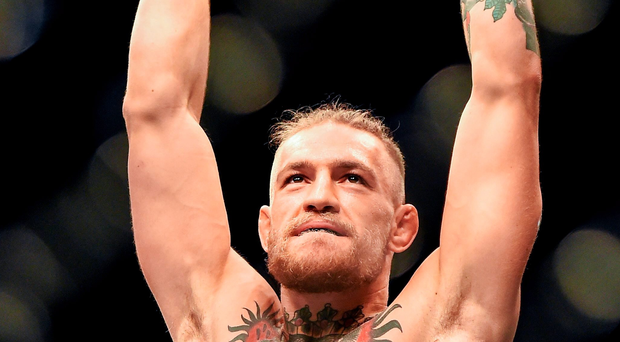 Conor McGregor celebrates his victory over Diego Brandao