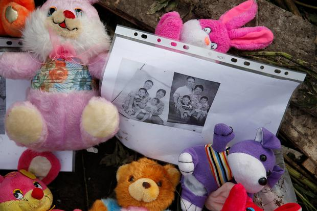 Mementos placed at the crash site of Malaysia Airlines Flight MH17 are pictured near the settlement of Rozspyne in the Donetsk region July 19, 2014
