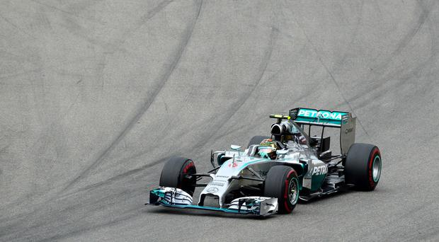 Mercedes driver Nico Rosberg of Germany cuts a curve during the German Formula One Grand Prix in Hockenheim