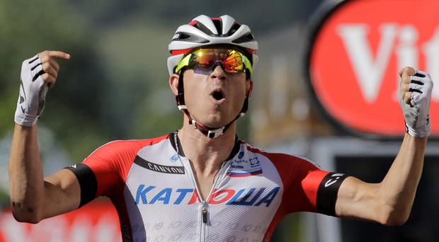 Norway's Alexander Kristoff crosses the finish line to win the twelfth stage of the Tour de France cycling race over 185.5 kilometers (115.3 miles) with start in Bourg-en-Bresse and finish in Saint-Etienne, France