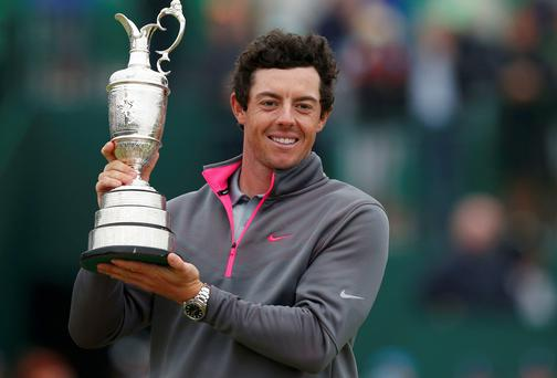 Rory McIlroy celebrates as he holds the Claret Jug after winning the British Open Championship at the Royal Liverpool Golf Club.