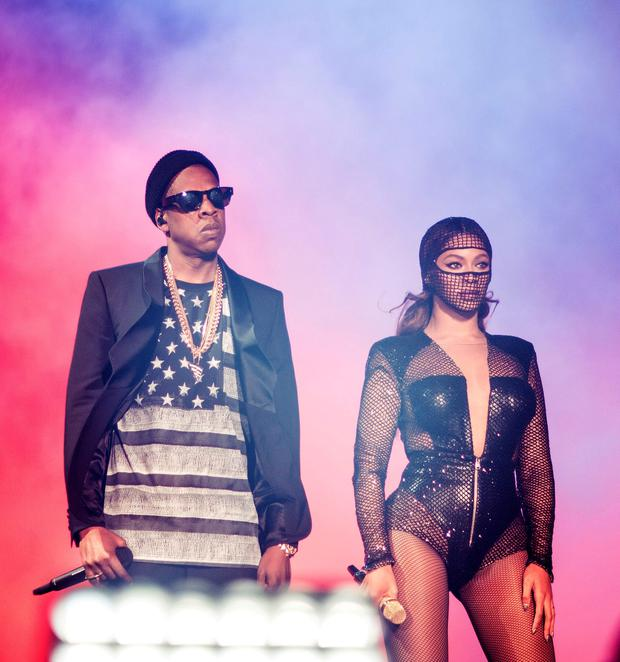 Beyonce and JAY Z performs during the On The Run tour at Mercedes-Benz Superdome in New Orleans. (Photo by Robin Haper/Invision for Parkwood Entertainment/AP Images)