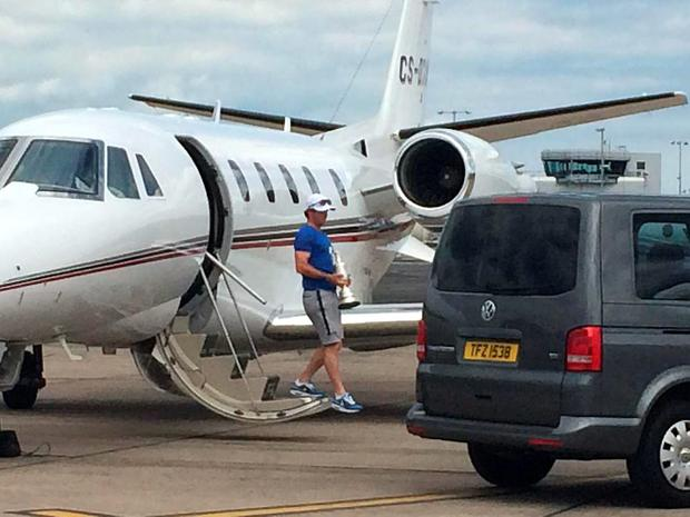Rory exits the jet with his trophy. Credit: Belfast City Airport