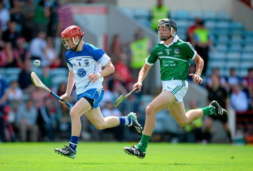 Andy Molumby, Waterford, in action against Colin Ryan, Limerick. The two sides will compete again tonight in a replay to decide who emerges as Munster minor champions. Picture credit: Brendan Moran / SPORTSFILE