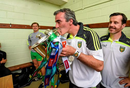 Donegal manager Jim McGuinness celebrates with the Anglo Celt Cup in the dressing-room after his side's Ulster SFC final win over Donegal. Photo: Paul Mohan / SPORTSFILE