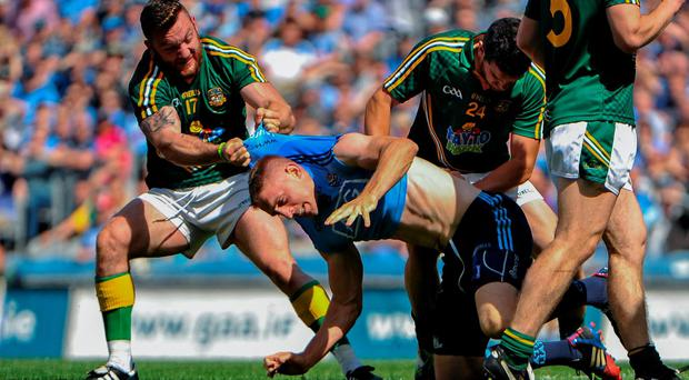 Meath's Mickey Burke hauls Eoghan O'Gara of Dublin away after the two clashed in an off-the-ball incident during the Leinster SFC final. Photo: Ashleigh Fox / SPORTSFILE