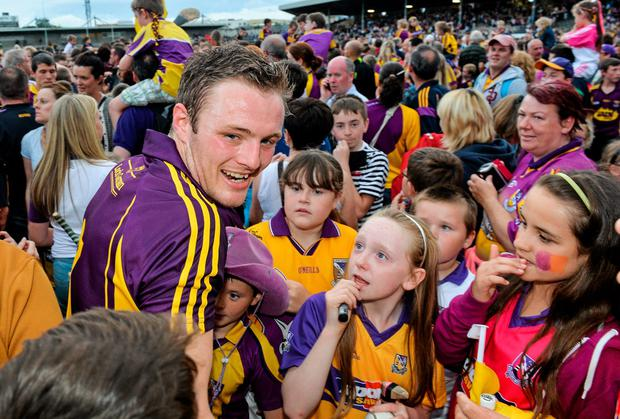 Jack Guiney celebrates with supporters after Wexford's win over Waterford. Demand for tickets for the county's All-Ireland qualifier against Limerick this weekend is soaring. Photo: Ray McManus / SPORTSFILE
