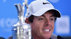 HOYLAKE, ENGLAND - JULY 20: Rory McIlroy of Northern Ireland answers questions from the media after his two-stroke victory at The 143rd Open Championship at Royal Liverpool on July 20, 2014 in Hoylake, England. (Photo by Stuart Franklin/Getty Images)