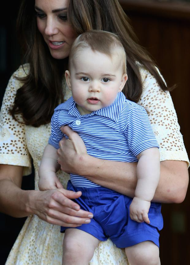 Catherine, Duchess of Cambridge holds Prince George of Cambridge as they visit the Bilby Enclosure at Taronga Zoo on April 20, 2014 in Sydney