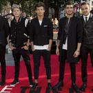 One Direction, (L-R) Harry Styles, Niall Horan, Louis Tomlinson, Zayn Malik and Liam Payne pose for photographers at the world premiere of their film