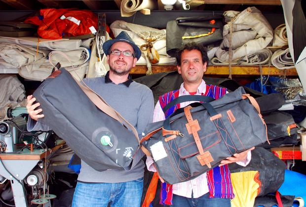 Brothers Attila and Levente Magyar with the life rafts from tall ship Astrid which the new Mamukko bags have been made from