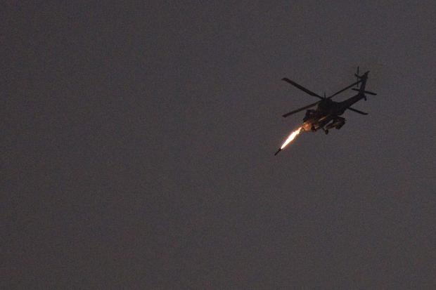 An Israeli Apache helicopter fires a missile towards the Gaza Strip. Reuters