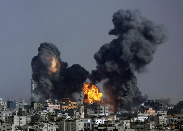 Smoke and fire from the explosion of an Israeli strike rise over Gaza City, Gaza Strip, Tuesday, July 22, 2014, as Israeli airstrikes pummeled a wide range of locations along the coastal area and diplomatic efforts intensified to end the two-week war. AP