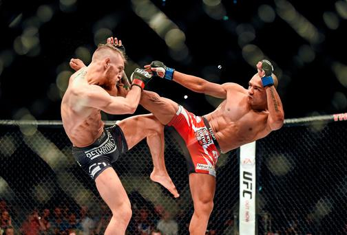 Conor McGregor (left) in action against Diego Brandao during Saturday's UFC featherweight bout at the O2. Photo: Paul Mohan / SPORTSFILE