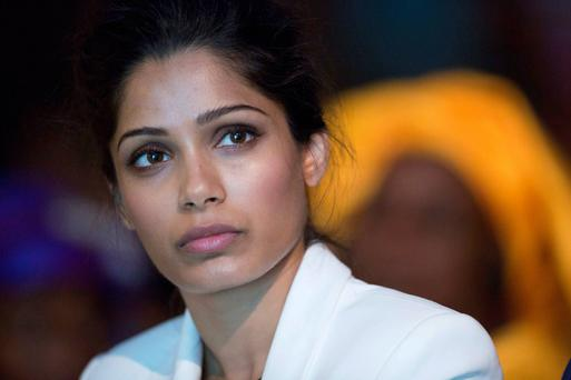 Freida Pinto at the 'Girl Summit 2014' yesterday and, below, in 'Slumdog Millionaire'. Reuters
