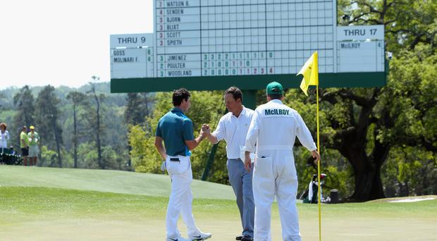 Rory McIlroy shakes hands with Augusta member Jeff Knox after their round at the 2014 Masters. Knox says he has offered McIlroy his help ahead of next year's tournament. Photo: Andrew Redington/Getty Images