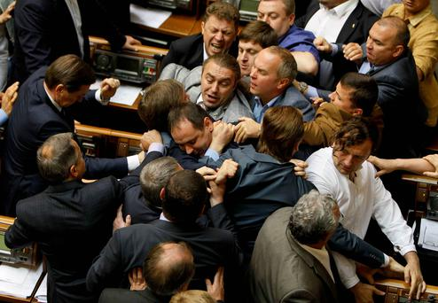 Ukrainian parliamentary deputies tussle during a session in Parliament in Kiev. Reuters
