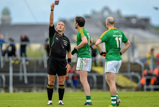 Leitrim's Darren Sweeney is shown the black card by referee Conor Lane during the first half of the Connacht SFC game against Roscomon back in May - the black cards seem to have dried up in recent weeks. Photo: Piaras O Midheach / SPORTSFILE