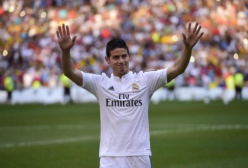 New Real Madrid signing James Rodriguez acknowledges the crowd during his presentation at the Santiago Bernabeu. Photo: PIERRE-PHILIPPE MARCOU/AFP/Getty Images